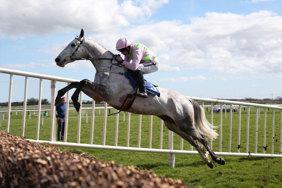 FAIRYHOUSE SUN 2 APRIL 2017 PICTURE: CAROLINE NORRIS   BALLYCASEY RIDDEN BY RUBY WALSH, WINNER, JUMPING THE LAST FENCE IN THE NORMANS GROVE STEEPLECHASE