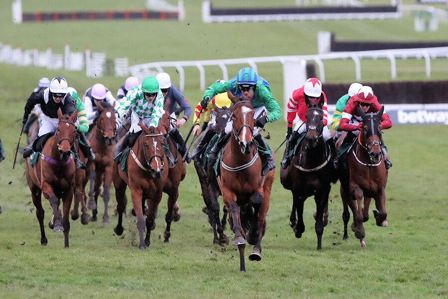 Cheltenham Wed 14 March March 2018  Picture: Caroline Norris Carefully Selected ridden by Danny Mullins, 2nd, leads the field in the closing stages of The Weatherbys Champion Bumper with Relegate ridden by Katie Walsh, left, winner, and Tornado Flyer ridden by Paul Townend, 3rd, beside her.